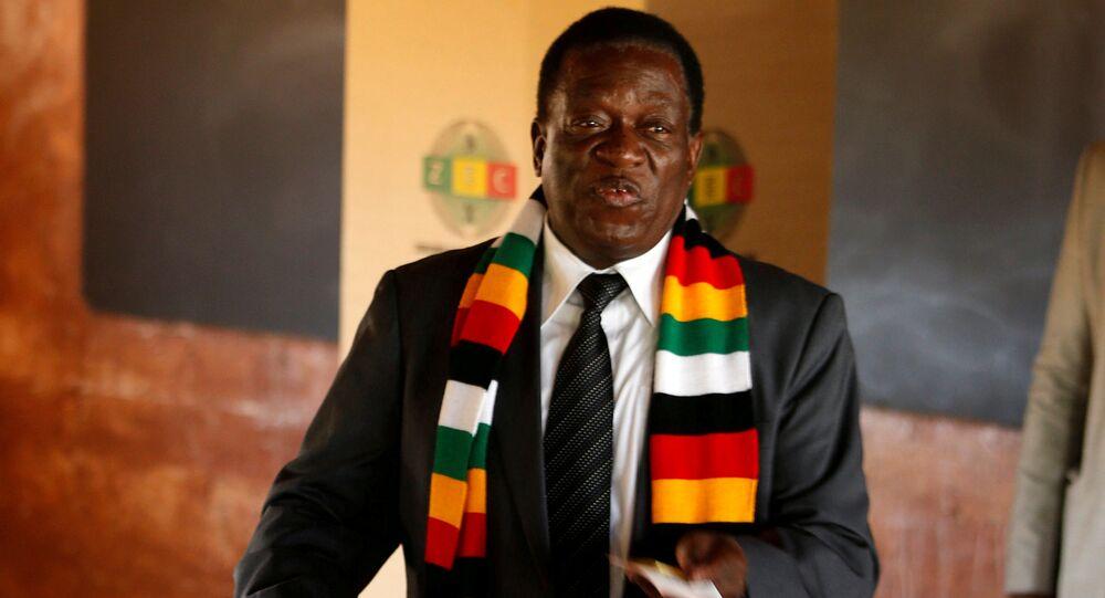 Zimbabwe's President Emmerson Mnangagwa votes in the general election at Sherwood Park Primary School in Kwekwe, Zimbabwe