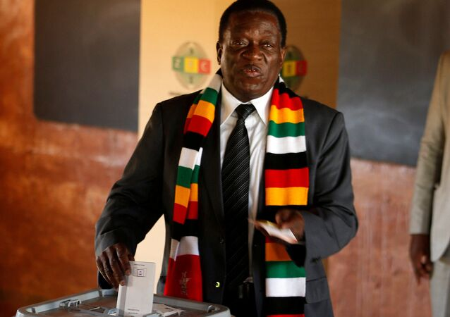 Zimbabwe's President Emmerson Mnangagwa votes in the general election at Sherwood Park Primary School in Kwekwe, Zimbabwe