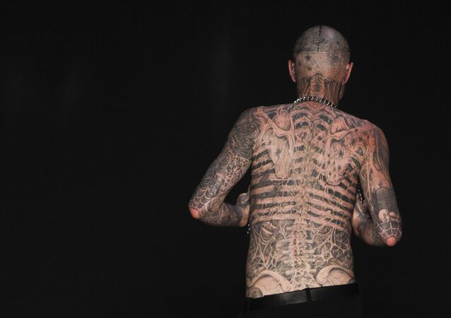 Canadian model Rick Genest, aka Zombie Boy, wears a creation by Auslander during the Fashion Rio Summer 2012 collection in Rio de Janeiro, Brazil, Saturday, June 4, 2011