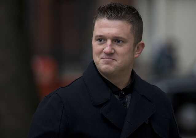 In this Oct. 16, 2013 photo, Tommy Robinson arrives for an appearance at Westminster Magistrates Court in London