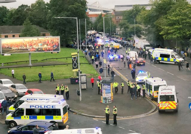 Police vehicles are seen near Ibrox Stadium due to a violence between fans during the match between Scotland's Glasgow Rangers and Croatia's NK Osijek in Glasgow, Scotland, Britain August 2, 2018, In this still image obtained from social media on August 3, 2018