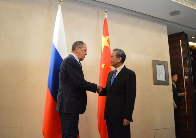 Russian Foreign Minister Sergei Lavrov Shake Hands with his Chinese counterpart Wang Yi