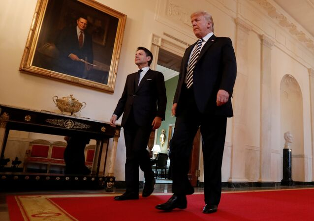 U.S. President Donald Trump and Italy's Prime Minister Giuseppe Conte arrive for a joint news conference in the East Room of the White House in Washington, U.S., July 30, 2018