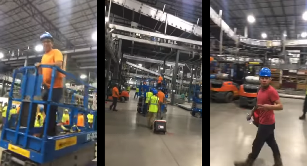 Viral video shows man jubilantly celebrating fellow workers' wildcat strike.