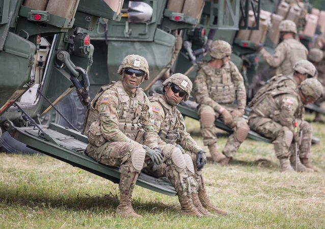 American Soldiers are seen during NATO Saber Strike military exercises on June 16, 2017 in Orzysz, Poland