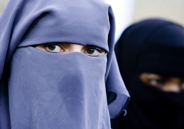 In this Thursday, Nov. 30, 2006 file photo Unidentified women are seen wearing a niqab during a demonstration outside the Dutch parliament against a proposed ban on the burqa, in The Hague, Netherlands. Belgian politicians will vote on April 22, 2010 on whether to ban the burqa and other body and face covering attire. The proposed ban could become law by July and apply to all public places, including streets