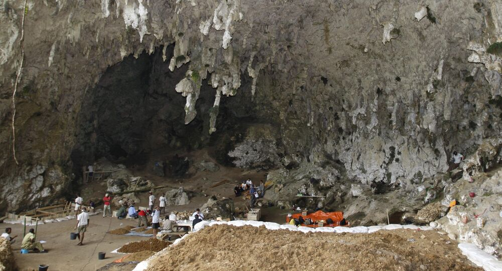 Workers labor at the Liang Bua cave excavation site where the remains of Homo floresiensis were discovered in Ruteng, Flores island, Indonesia (File)