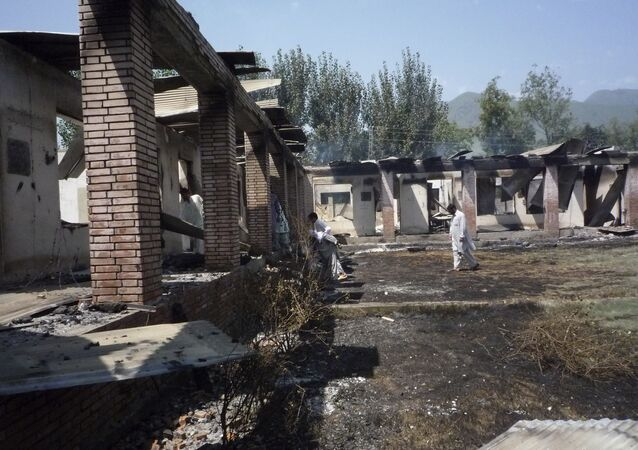 Local residents examine a burned government girls' school, torched by Islamic militants in Matta Durish Khaila near Mingora, the main town of Pakistan's Swat Valley, Wednesday, Aug. 20, 2008