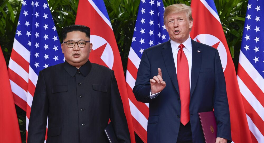 FILE - In this June 12, 2018, file photo, U.S. President Donald Trump makes a statement before saying goodbye to North Korea leader Kim Jong Un after their meetings at the Capella resort on Sentosa Island in Singapore