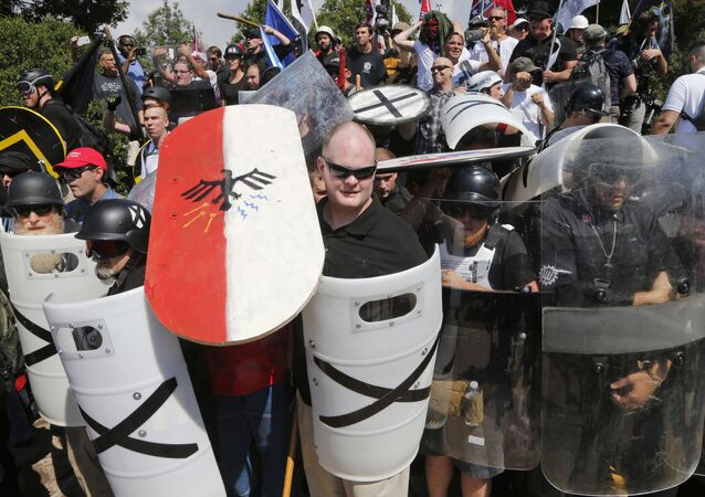 White nationalist demonstrators use shields in Charlottesville, VA, Aug. 12, 2017