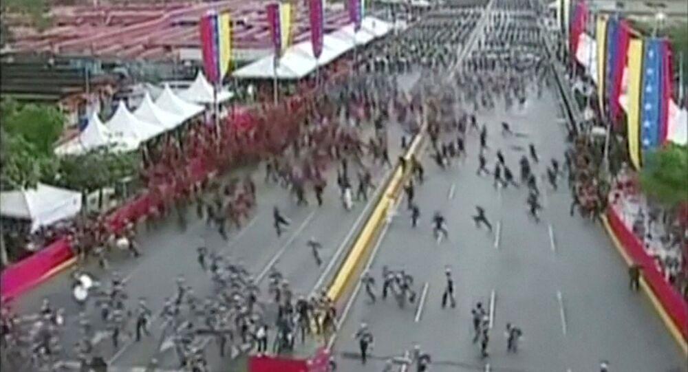Venezuelan National Guard soldiers run during an event which was interrupted, in this still frame taken from video August 4, 2018, Caracas, Venezuela.