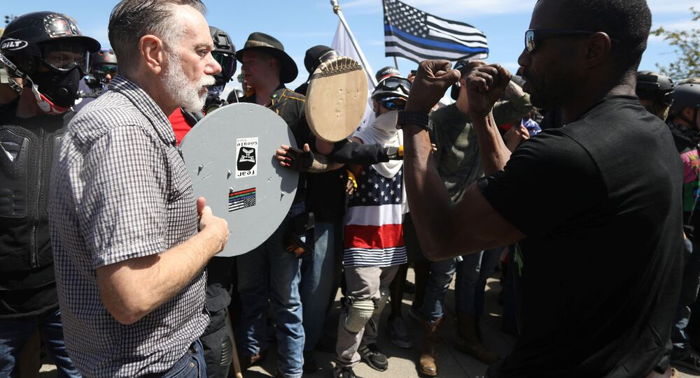 Right-wing supporters of the Patriot Prayer group (L) exchange words with a counter-demonstrator during a rally in Portland, Oregon, U.S. August 4, 2018.