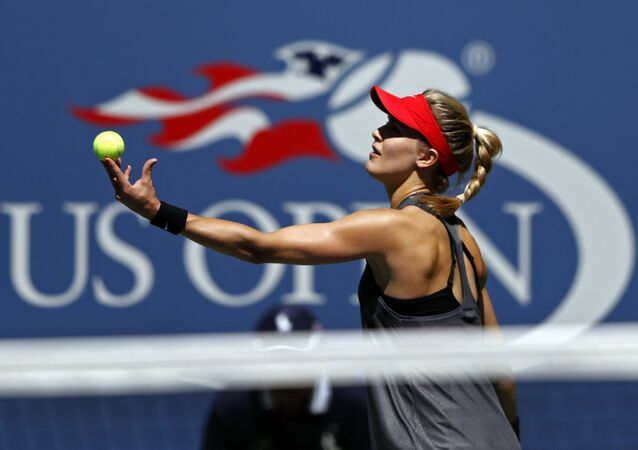 Eugenie Bouchard, of Canada, serves to Evgeniya Rodina, of Russia, during the first round of the U.S. Open tennis tournament, Wednesday, Aug. 30, 2017, in New York