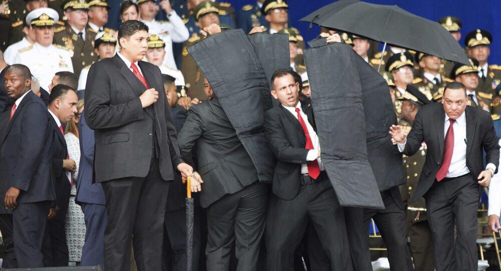Security personnel surround Venezuela's President Nicolas Maduro
