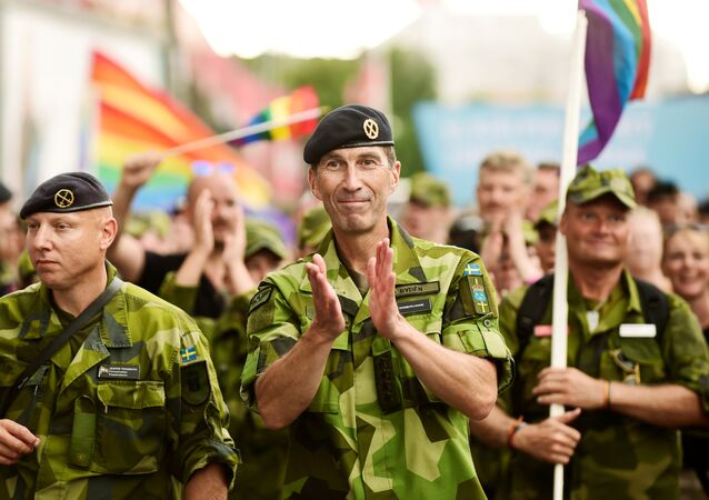 Supreme Commander of the Swedish Armed Forces Micael Byden with other members of the Armed Forces participate in Saturday's EuroPride Parade in Stockholm, Sweden August 4, 2018