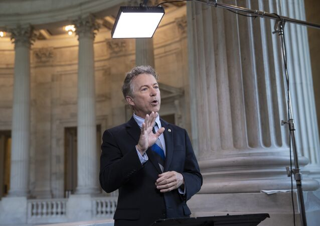 During a TV news interview, Sen. Rand Paul, R-Ky., defends President Donald Trump and his Helsinki news conference with Russian President Vladimir Putin whereTrump appeared to cast doubt on U.S. intelligence findings that Russia interfered in the 2016 election, on Capitol Hill in Washington, Tuesday, July 17, 2018