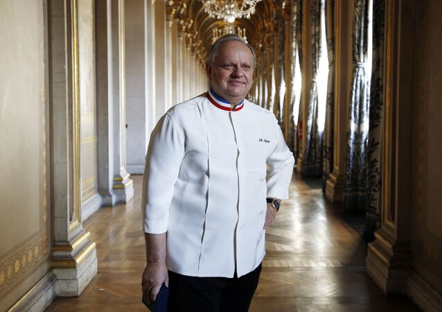 (FILES) In this file photo taken on January 14, 2016 French chef Joel Robuchon poses in a corridor in the Hotel de ville of Paris during the Grand Vermeil award ceremony, rewarding the best chefs of Paris. French chef, died at the age of 73, on August 6, 2018 according to the French government spokesperson