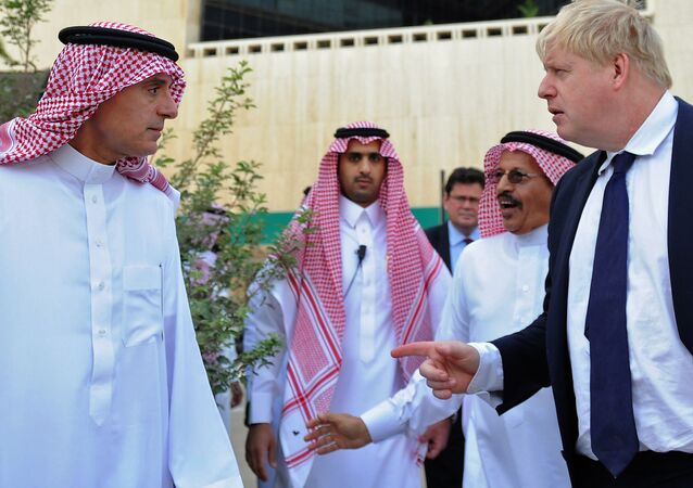 Saudi Foreign Minister Adel al-Jubeir (L) and his British counterpart Boris Johnson (R) tour the site of the first British embassy in the historic quarter of Jeddah on January 25, 2018.