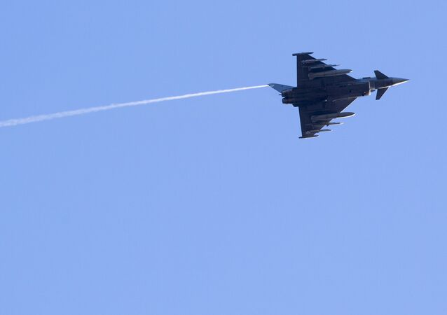 Spain's Eurofighter Typhoon jet fighter flies during the military exercise over Rukla military base some 120 km.