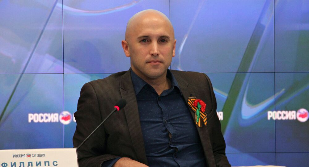 Journalist Graham Phillips at a news conference (File photo). British law enforcement detained him outside the Georgian Embassy in London.
