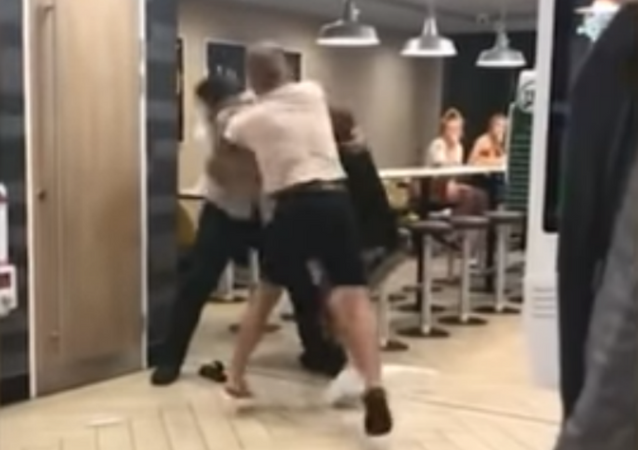 Two teenagers gang up on McDonald's employee after being asked to leave