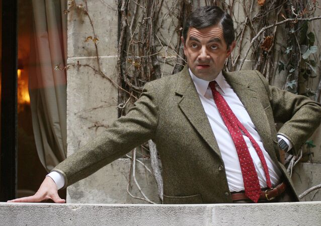 British actor Rowan Atkinson poses during a photocall at the presentation of his last movie 'Mr. Bean's Holiday', 11 April 2007 in Paris. The movie will be released in France the 18 April 2007.