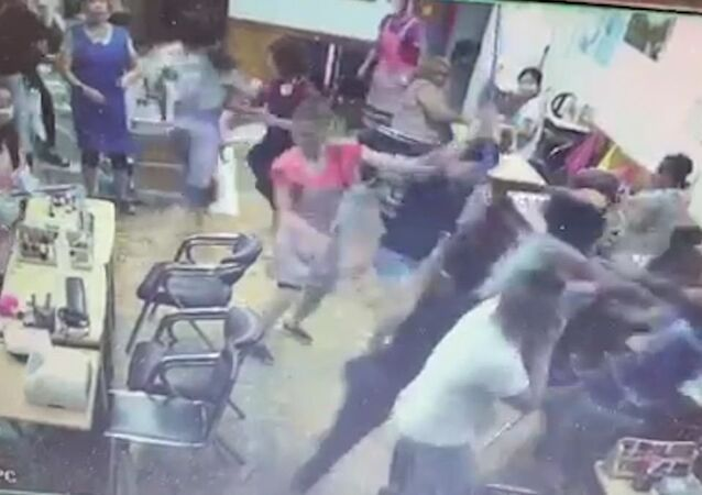 Surveillance footage shows multiple women punching and pushing each other in a Brooklyn nail salon
