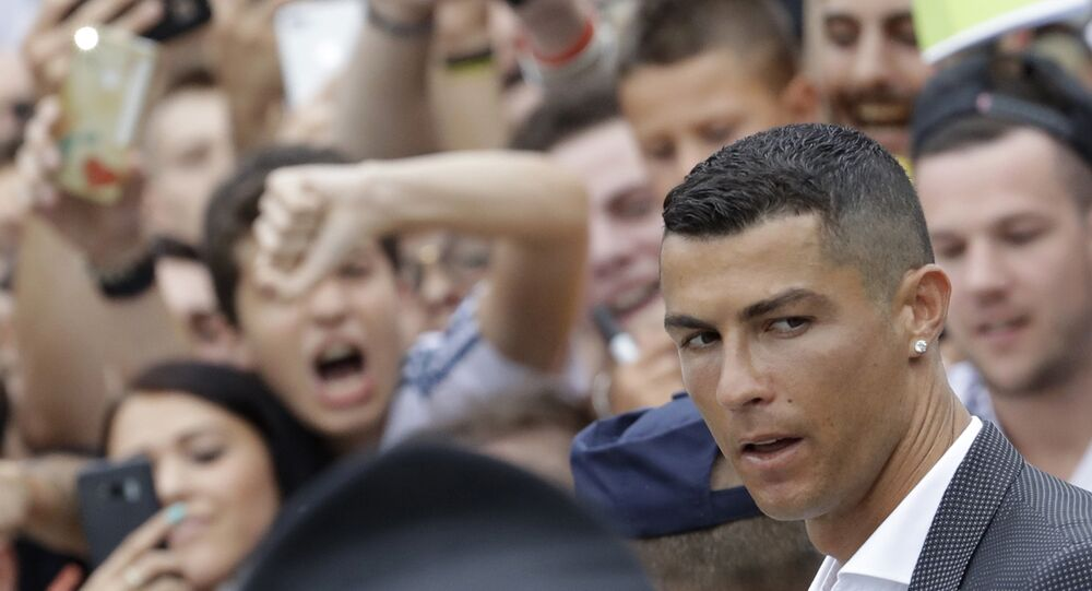 Portuguese ace Ronaldo passes among enthusiast fans as he arrives to undergo medical checks at the Juventus stadium in Turin, Italy, Monday, July 16, 2018