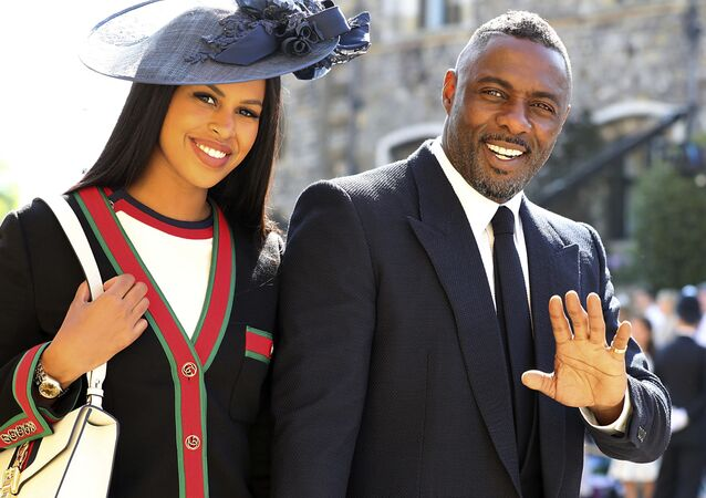 Idris Elba and Sabrina Dhowre arrive for the wedding ceremony of Prince Harry and Meghan Markle at St. George's Chapel in Windsor Castle in Windsor, near London, England, Saturday, May 19, 2018.