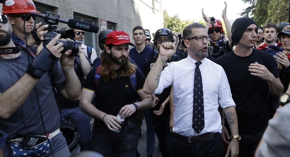 Gavin McInnes is surrounded by supporters after speaking at a rally Thursday, April 27, 2017, in Berkeley, California.