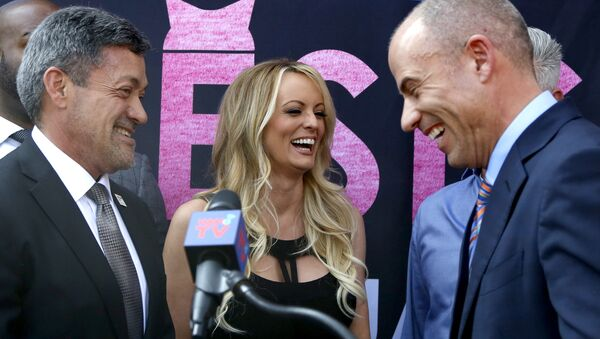 West Hollywood Mayor John Duran, left, Stormy Daniels, center, and attorney Michael Avenatti attend a ceremony for Daniels receiving a City Proclamation and Key to the City on Wednesday, May 23, 2018 in West Hollywood, Calif - Sputnik International