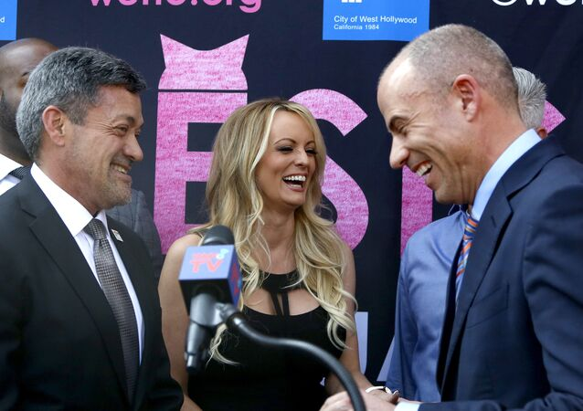 West Hollywood Mayor John Duran, left, Stormy Daniels, center, and attorney Michael Avenatti attend a ceremony for Daniels receiving a City Proclamation and Key to the City on Wednesday, May 23, 2018 in West Hollywood, Calif