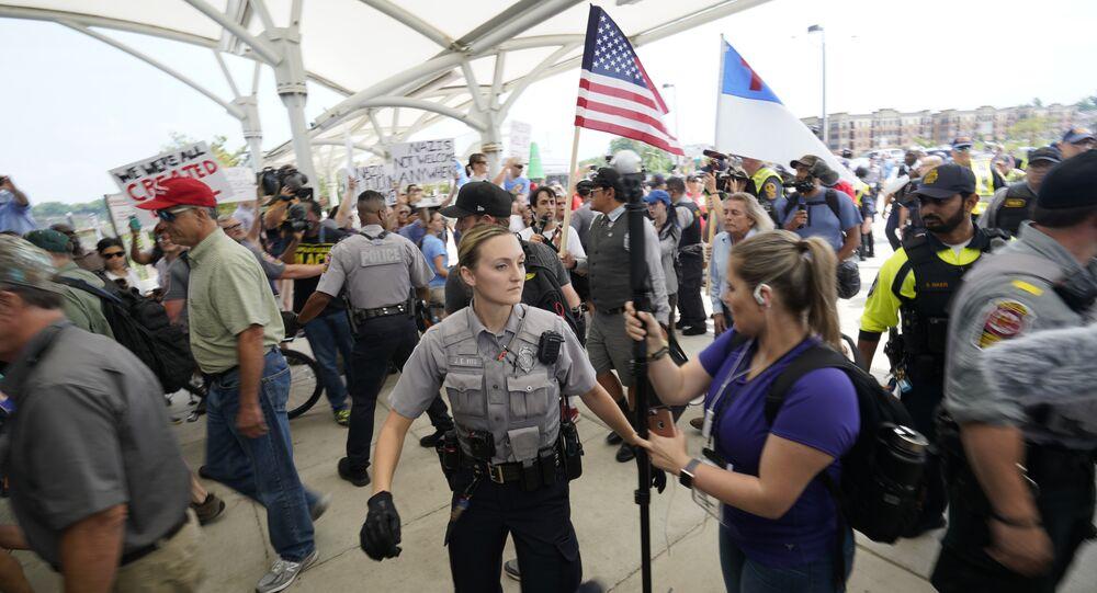 White supremacists enter the Vienna metro station in Vienna, Va., near Washington DC on Sunday, Aug. 12, 2018.