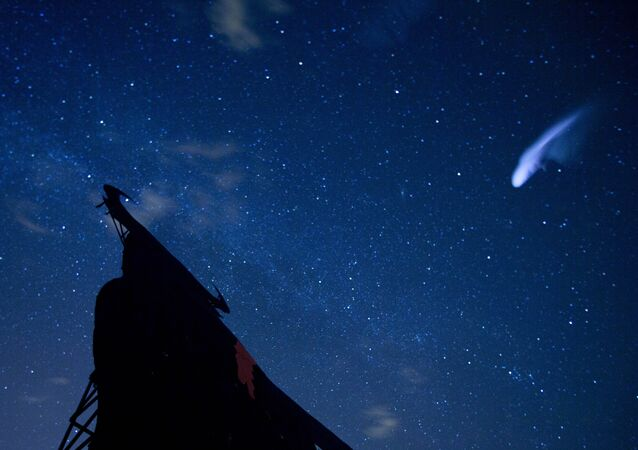 a streak appears in the sky during the annual Perseid meteor shower