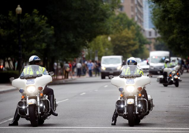 Police on motorcycles are pictured near a protest against the white nationalist-led Unite the Right rally held in front of the White House on the one-year anniversary of the white nationalist-led rally in Charlottesville, VA, in downtown Washington, U.S., August 12, 2018.