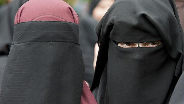 In this June 28, 2014 file photo veiled women attend a speech by preacher Pierre Vogel, in Offenbach, near Frankfurt, Germany. A law that forbids any kind of full-face covering, including Islamic veils such as the niqab or burqa, has come into force in Austria Sunday, Oct. 1, 2017. Only a small number of Muslim women in Austria wear full-face veils, but they have become a target for right-wing groups and political parties. France and Belgium have similar laws and the nationalist Alternative for Germany party is calling for a burqa ban there too - Sputnik International