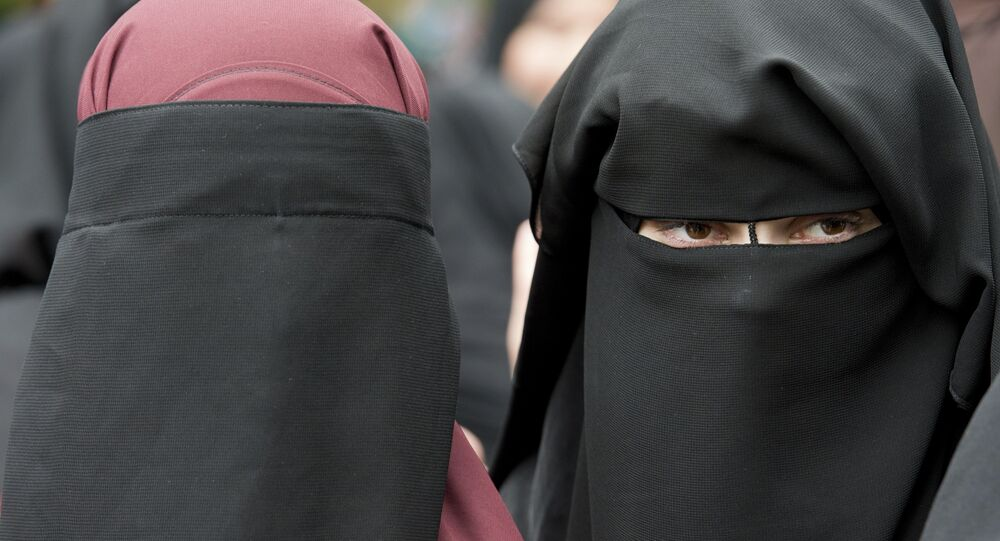 Women in full-face veil