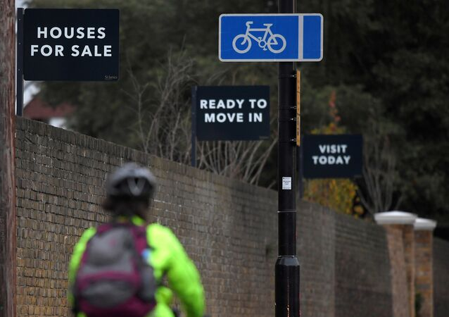 Property sale signs are seen outside of a group of newly built houses in west London, Britain, November 23, 2017