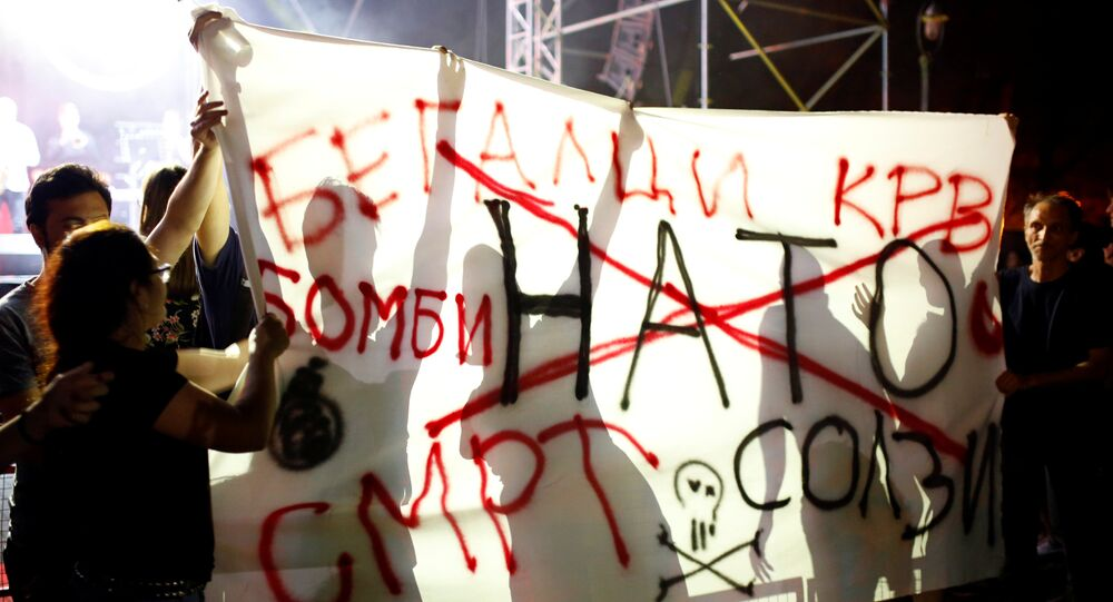 Anti-NATO protestors hold a banner with the message NATO refugees blood bombs death tears during events organized by the government in 15 towns to celebrate an invitation for Macedonia to join NATO, in Skopje, Macedonia July 14, 2018