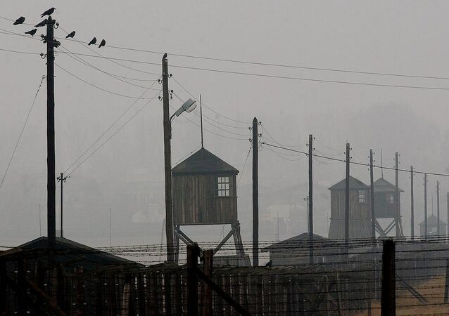 Watch towers and the barbed wire fence of the former Nazi death camp Majdanek outside the city of Lublin in eastern Poland on Wednesday Nov. 9, 2005. Four camp survivors and documentary film makers dug up trinkets and personal items buried by Jews in the spring of 1943 after arriving from the Warsaw ghetto