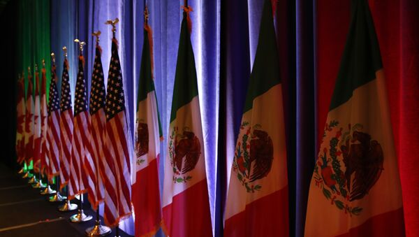 In this Aug. 16, 2017 file photo, the national flags of Canada, the U.S. and Mexico are lit by stage lights before a news conference, at the start of the North American Free Trade Agreement renegotiations in Washington - Sputnik International