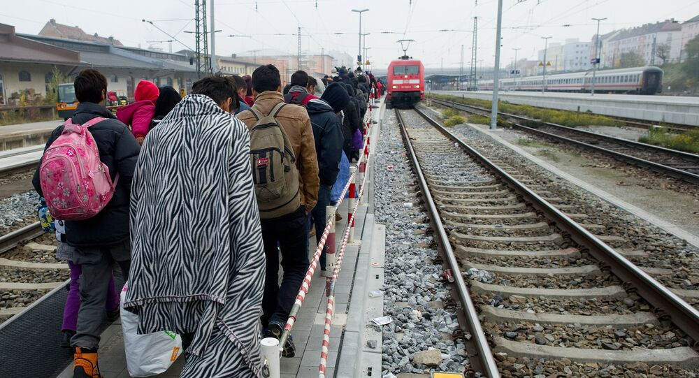 Migrants walk on a platform of the railway station in Passau, southern Germany, to a special train to bring them to Duesseldof, western Germany, on November 3, 2015