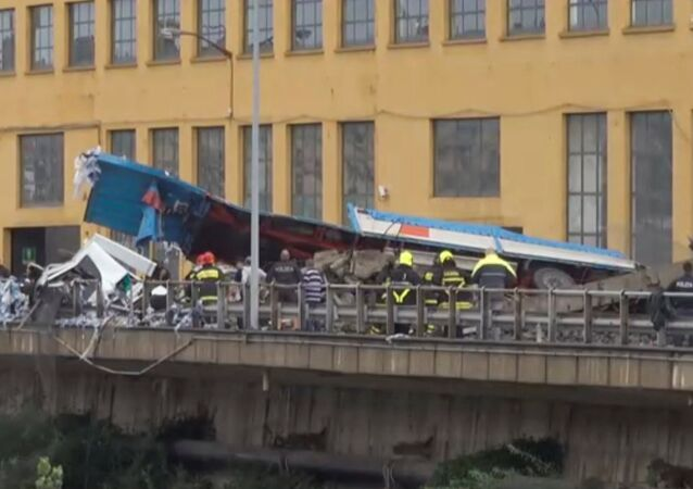 Rescue workers are seen at the collapsed Morandi Bridge in the Italian port city of Genoa, Italy August 14, 2018 in this still image taken from a video