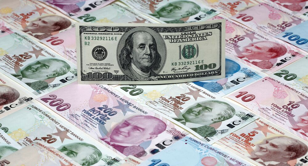 A picture illustration shows a 100 Dollar banknote laying on various denomination Turkish lira banknotes, taken in Istanbul, Turkey January 7, 2014