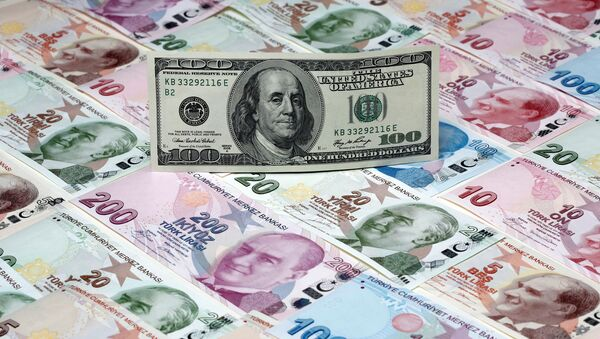 A picture illustration shows a 100 Dollar banknote laying on various denomination Turkish lira banknotes, taken in Istanbul, Turkey January 7, 2014 - Sputnik International