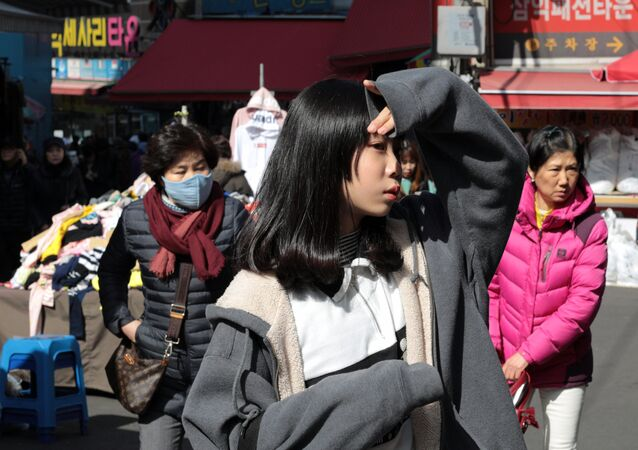 People in the Namdaemun trade district in Seoul.