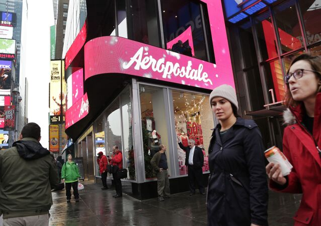 FILE - In this Wednesday, Dec. 2, 2015, file photo, women pass an Aeropostale clothing store in New York's Times Square.