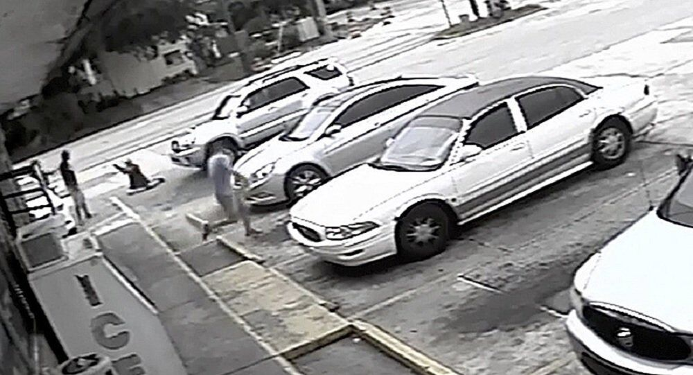 In this Thursday, July 19, 2018 image taken from surveillance video released by the Pinellas County Sheriff's Office, Markeis McGlockton, far left, is shot by Michael Drejka during an altercation in the parking lot of a convenience store in Clearwater, Fla. The family of McGlockton issued an appeal Tuesday, July 24, 2018, through an attorney for the public to put pressure on State Attorney Bernie McCabe to file charges against Drejka, a white man who fatally shot the black father of three last Thursday upon being pushed to the ground outside a convenience store.