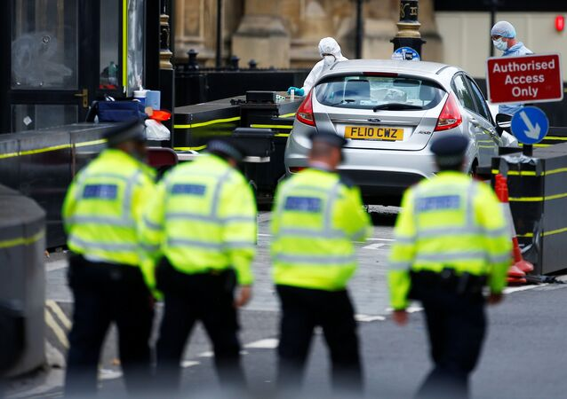 Forensic investigators work at the site after a car crashed outside the Houses of Parliament in Westminster, London, Britain, August 14, 2018