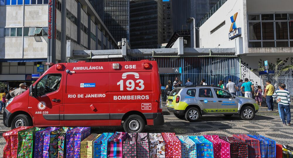 An ambulance of the fire department is seen outside the Carioca station where a man was rescued after falling onto the tracks of the Rio de Janeiro